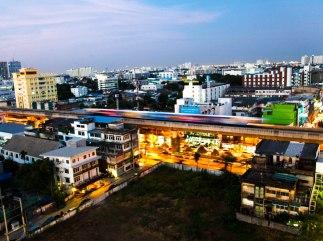 A train passes through in Bangkok.