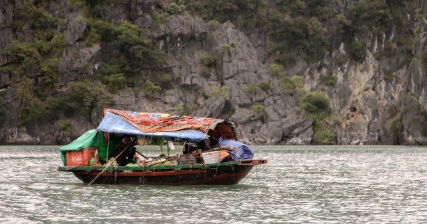 A floating shop (and home) on its way to the floating market to sell.