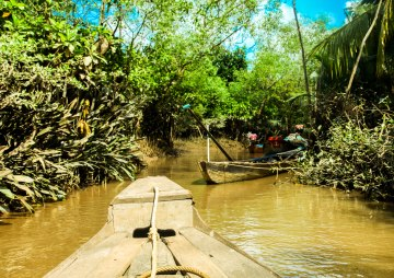 Paddling into a small village.