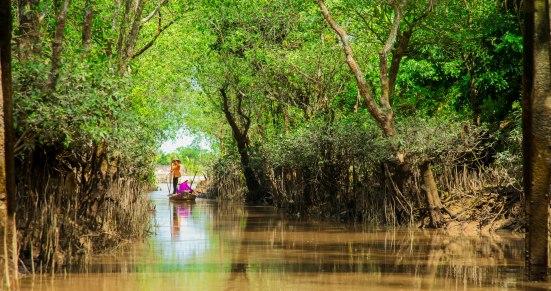 A woman gliding down the Mekong.