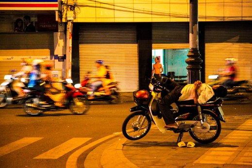 Resting on a motorbike in the middle of Ho Chi Minh.