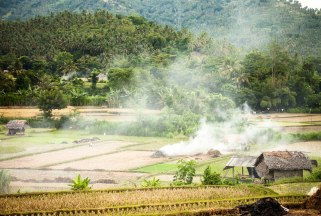The smoky landscape of the farms of Lombok.