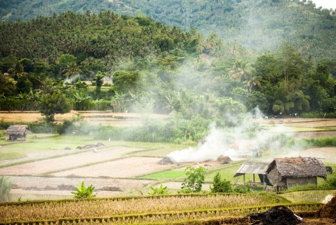 The smoky landscape of the farms of Lombok.