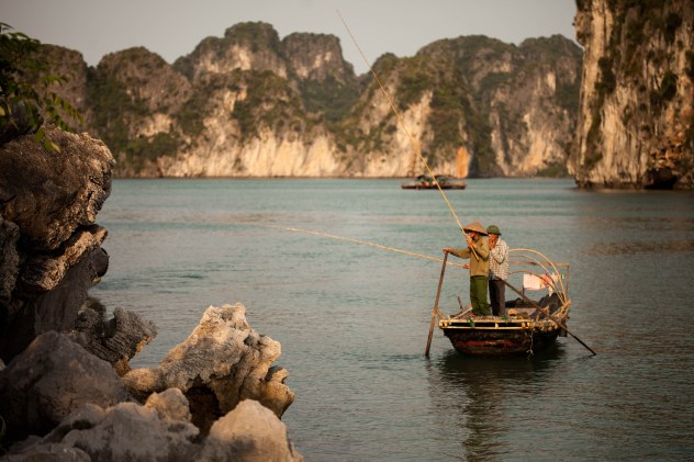 Fishermen catching their dinner on Halong Bay.